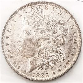 1885 O Morgan Silver Dollar: An 1885 O Morgan silver dollar. Designer: George T. Morgan. Mintage: 9,185,000. Metal Content: 90% silver, 10% copper. Diameter: 38.1 mm. Weight: 26.73 grams. Very good condition.