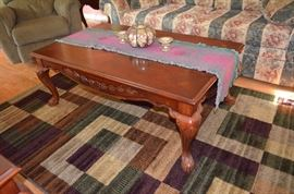 Carved Oak Coffee Table part of a set of 3 and area rug