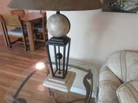 Elegant table lamp with rod iron and marble in the base on décor under the lamp shade.