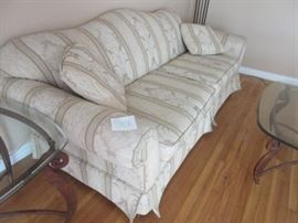 Beautiful fine upholstery material on this 8' couch with two large bench seat cushions and two throw pillows.