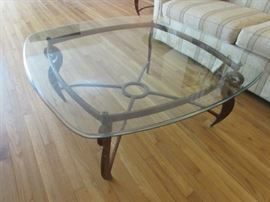 Beautiful beveled glass top solid and heavy base legs coffee table.