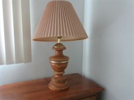 Solid wood carved lamp base with shade.