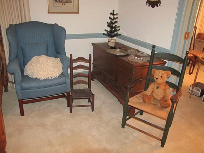 One of two wing chairs; two drawer blanket chest; early arm chair