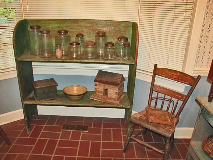 Bucket bench in green paint, pantry jars
