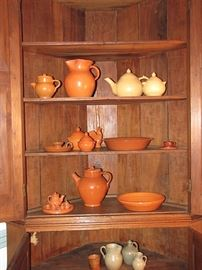 Jugtown pottery in orange and buff