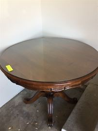 Solid walnut round dining or occasional table with glass top. Perfect condition!
