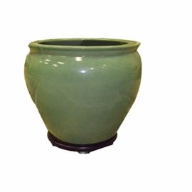 Large Green Planter with Wooden Stand: A large green planter with wooden stand. The planter is ceramic. It matches item 128 in this sale.