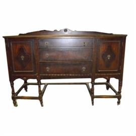 Antique Mahogany Buffet: An antique mahogany buffet. The buffet has dove tail drawers. It is on casters.There are three drawers and two cabinet doors. It is marked 860-HL on back.