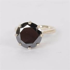 Black Diamond and Sterling Silver Ring: A black diamond and sterling silver ring.