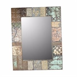 Ceiling Tile Wall Mirror: A ceiling tile wall mirror. The tiles are metal with a wooden frame. They have a worn look with a variety of muted paint colors.