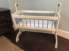 Rock A Bye that little baby in this vintage cradle