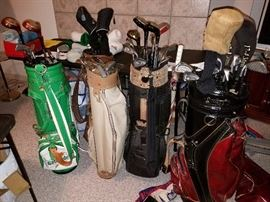 Golf bags and clubs.