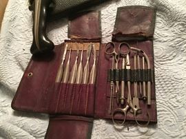 Several sets of antique medical equipment from the early 1900's