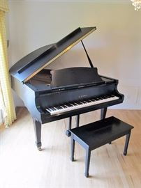 "AUCTION HIGHLIGHT: Kawai RX-2 grand piano (5' 10"") in matte finish, with bench. This piano has been cherished by the family since it was purchased, having been played regularly."