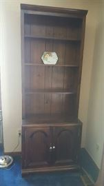 Tall brown display cabinet  $50