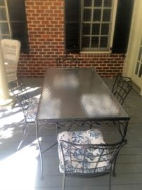 Glass top/iron frame outdoor table & 4 chairs