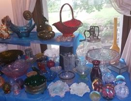 Vintage glassware including some Depression glass, art glass paperweights (2 are St. Clair), and a lovely Indiana Glass amberina basket. Fabulous antique kitchen churn is at the back of the picture.