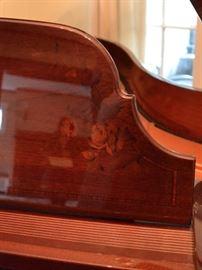 Polished mahogany with inlay decoration
