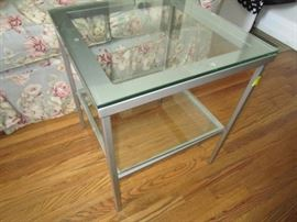 One of many metal and glass tables