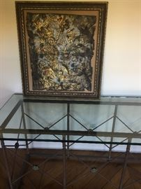 Gorgeous glass topped French console table with a Framed antique Spanish tooled leather piece gorgeous frame one of a kind!
