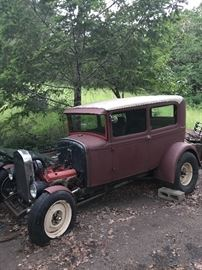 1930 Ford model A Steel 'Tudor' body stlye 'Project Car'    Car has not been run in 14 years.  Does not currently run.  Car body in good shape.   Chevy 327 engine, big wheels on back.  Front wheels have 'articulating fenders'.