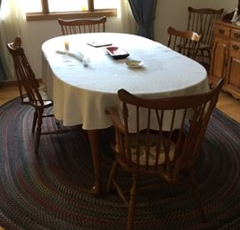 Solid cherry dining set with 2 captains chairs, 6 side chairs, 3 leaves and custom made protective pad.
