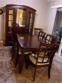 Dining room table, leaf and 6 chairs with Lighted china cabinet