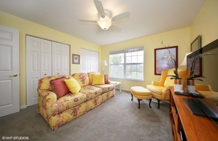 Beautiful sunny yellow print sofa and yellow high back chair with ottoman.