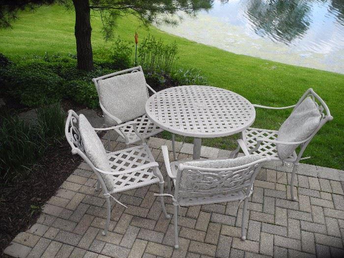 Great four piece iron patio set