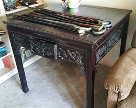 Incredible carved rosewood desk/table with four drawers