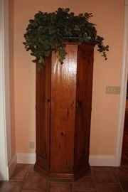 Wood Cabinet and Decorative Foliage