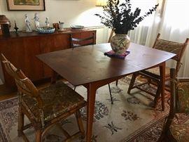 Mid Century Modern dining room table, rug