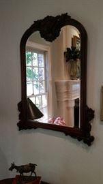 This hand carved/ beveled glass  antique mirror will enhance the beauty of your home for many years to come.