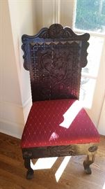 There are two hand carved wood back, upholstered seat side chairs, early vintage.  The other one is shown later in the pictures.