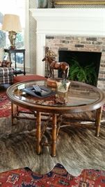 Round coffee table , beveled glass and bamboo stretcher legs.