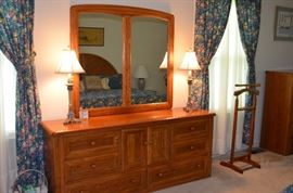 Gorgeous Matching Bedroom Suite includes: Double Door 4 Drawer Armoire, Double Mirror Dresser with 6 Drawers and Center Double Doors, 2 Double Drawer Night Stands/Lamp Tables, with 6 Drawer Chest  and beautiful Arched Headboard!
