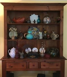 Display and Storage Pine Hutch with Wizard of Oz Style Winged Monkey, Pitchers and Carafes, Bronze Monkey, End of the Day Pitcher and Tumbler, Antique Papier Mache Box, Griffin, Lucy and Ethel Carry Box; Cast Resin Armadillo; Much More