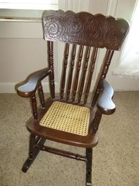 VINTAGE CHILD'S ROCKER WITH CANE SEAT AND CARVED BACK