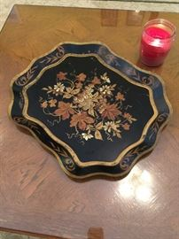 A great tin tray - put it on a table, hang it on the wall, use it on the patio, put perfume on it, towels on the vanity.....