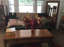 Beautiful coffee table  Futon couch / bed  Ornate gold tall candle holders