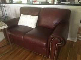 Red leather sofas & chair with ottoman