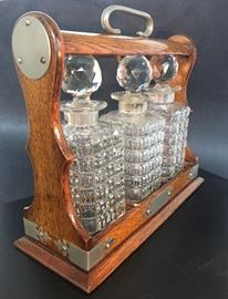 Antique Tantalus with cut glass decanters Pink Sign Estate Sale: Corsicana, TX July 19th - 22nd, 2017