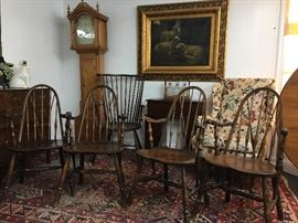 Antique Windsor Brace Back Arm Chairs with great patina of the beautiful grain wood.  There is a total of five of these matching antique Windsor chairs.