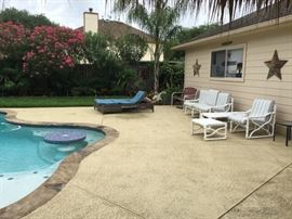 2nd View: The backyard with pool.  Lots of outdoor and pool side Furniture.