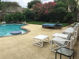 The backyard with pool.  Lots of outdoor and pool side furniture.