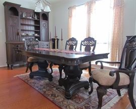 """Mollai Collection Dinning Room Suite. Cherry finished Rubber wood.  Double Pedestal Extension Table with 2 Leaves (18""""ea) with 6 Side Chairs and 2 Arm Chairs with intricate wood Details.  Table w/o leaves measures 78""""L x 44""""W) and a Oriental Rug (7'6""""x4'9"""")"""