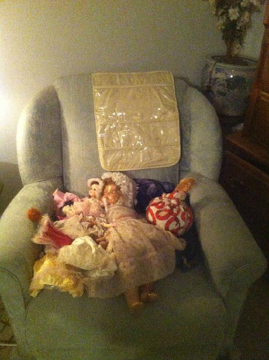 upholstered chair and dolls
