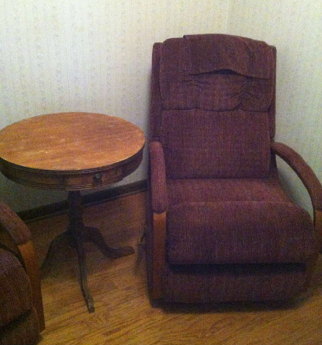 One of two recliners with drum table