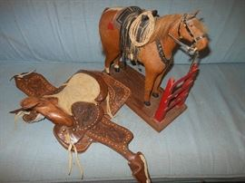 Antique roping horse and small hand made saddle