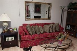 Bassett Couch and oval coffee table and gold framed mirror